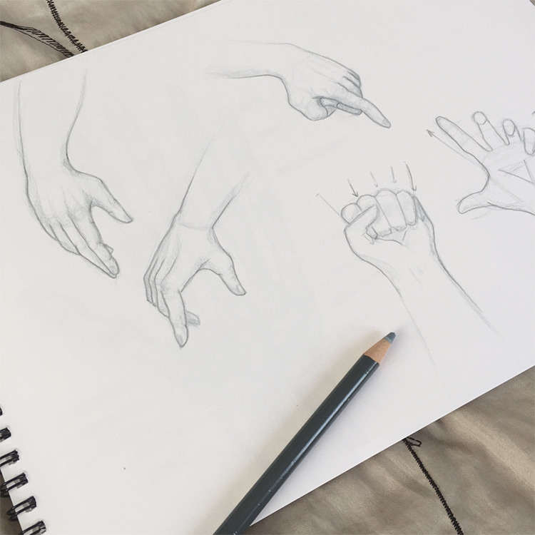 Clean drawings of hands in sketchbook