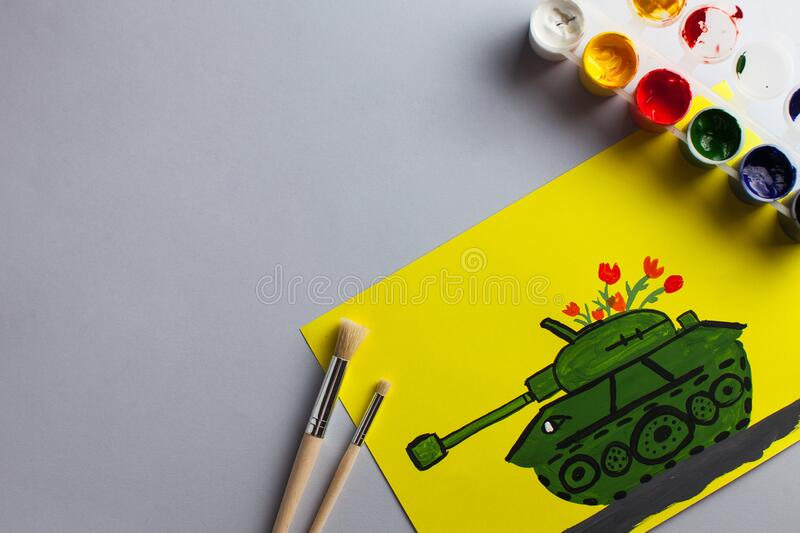 Children`s drawing of the tank on the anniversary of Victory Day. Greeting card for May 9. Creativity. Copy space. Children`s drawing of a tank as a gift for the vector illustration