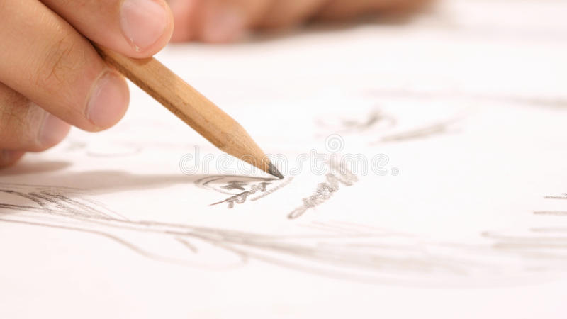 Close Up of Hand with Pencil Drawing Sketch on Paper royalty free stock photo