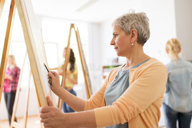 Woman artist with pencil drawing at art school stock photo